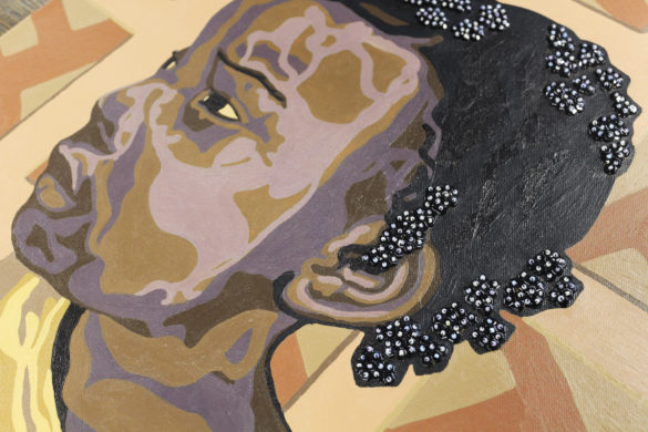 A portrait of a young black girl looking to the left. Traditional Haitian beadwork and sequins decorate the girl's hair.